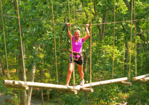 Cross a series of bridges in an obstacle at Tree to Tree Adventure Park - by the Cape May Zoo!